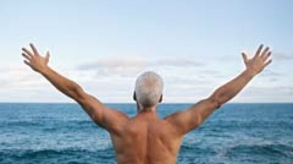 240-man-grey-hair-beach-arms-outstretched