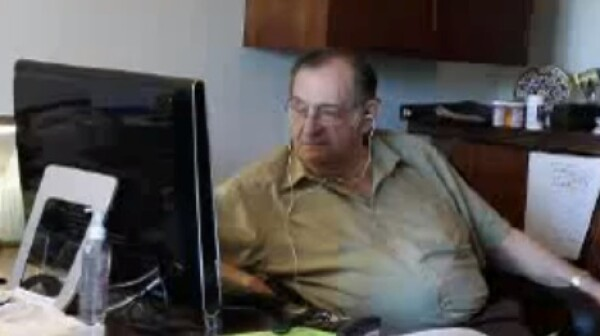Man at desk on computer