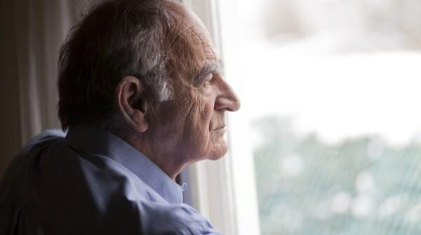 Man gazing out sad profile