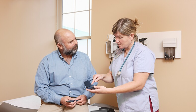 nurse-explaining-diabetic-equipment-to-patient