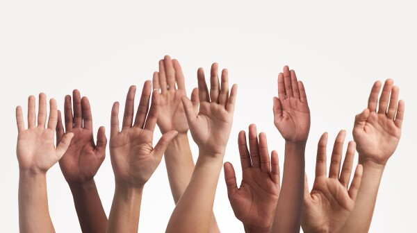 group of raised hands