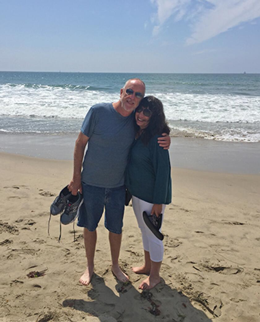 Ann Brenoff and her husband on the beach