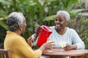 Two older women having lemonade