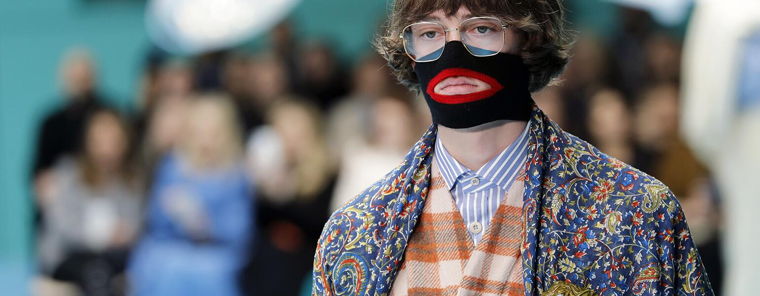 A photo of a model from the Gucci fashion show, featuring a face warmer made to resemble blackface.